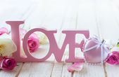 "Letters ""love"" and flowers — Stock Photo"