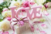 """Letters """"love"""" and flowers — Stock Photo"""