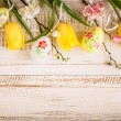 Easter eggs and spring flowers — Stock Photo #65160905