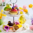 Assorted cakes and pastries on a cake — Stock Photo #70821263
