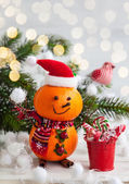 Snowman made out of tangerines — Stock Photo