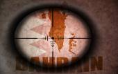 Sniper scope aimed at the vintage bahrain flag and map — Stock Photo