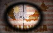 Sniper scope aimed at the vintage malaysian flag and map — Stock Photo