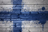 Painted finnish flag on a wooden texture — Stock Photo