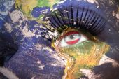 Woman's face with planet Earth texture and austrian flag inside the eye.  — Stock Photo