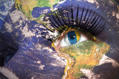 Woman's face with planet Earth texture and canarian flag inside the eye.  — Stock Photo