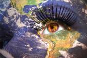 Womans face with planet Earth texture and sri lanka flag inside the eye. — Stock Photo