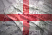 Colorful waving english flag on a euro money background — Stock Photo