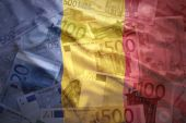 Colorful waving romanian flag on a euro money background — Stock Photo
