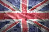 Colorful waving british flag on a euro money background — Stock Photo
