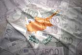 Colorful waving cypriot flag on a euro money background — Stock Photo