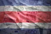 Colorful waving costa rican flag on a euro money background — Stock Photo