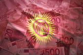 Colorful waving kyrgyzstan flag on a euro money background — Stock Photo