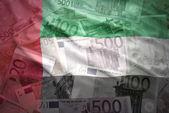 Colorful waving united arab emirates flag on a euro money background — Stock Photo