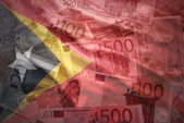 Colorful waving east timor flag on a euro money background — Stock Photo