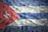 Colorful waving cuban flag on a american dollar money background — Stock Photo