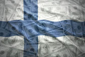 Colorful waving finnish flag  on a american dollar money — Stock Photo