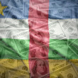 Colorful waving central african republic flag on a american dollar money background — Stock Photo #77584046