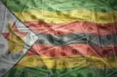 Colorful waving zimbabwean flag on a american dollar money background — Stock Photo