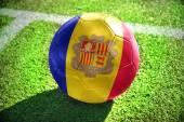 Football ball with the national flag of andorra  on the field — Photo