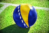 Football ball with the national flag of bosnia and herzegovina on the field — Photo