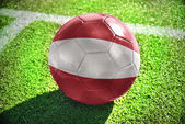 Football ball with the national flag of latvia on the field — Stock Photo