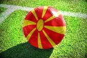 Football ball with the national flag of macedonia on the field — Foto de Stock