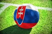 Football ball with the national flag of slovakia on the field — Stock Photo