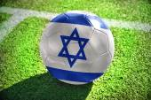 Football ball with the national flag of israel — Stock Photo