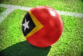 Football ball with the national flag of east timor — Stock Photo