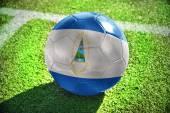 Football ball with the national flag of nicaragua — Stock Photo