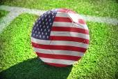 Football ball with the national flag of united states of america — Stock Photo