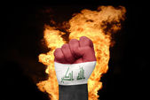Fire fist with the national flag of iraq — Stock Photo