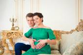 Cute young couple embracing tenderly pregnant tummy. — Stock Photo
