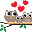 A sweet little owl family — Stock Vector #60753065