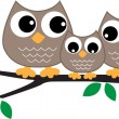 A sweet little owl family — Stock Vector #60753069