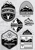 Set of templates for emblems with mountains — Stock Vector