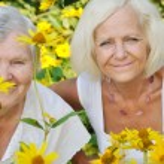 Senior and mature women in garden — Stock Photo #56551859