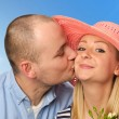 Young man kissing attractive woman — Stock Photo #56552871