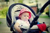 Baby in carriage. — Stock Photo