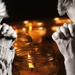 Praying man and woman with candles on background. — Stock Photo #63394871