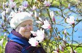 Senior woman in the garden — Stock Photo