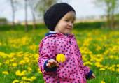 Young girl on meadow with flowers — Стоковое фото