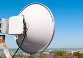 Antenna cellular base station against the blue sky — Stock Photo