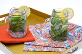 Cold Water with Lemon and Mint in Glass Jars — Stock Photo