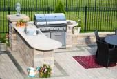 Stylish outdoor kitchen on a brick patio — Stock Photo