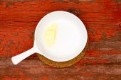 Melting Butter on White Serving Plate with handle — Stock Photo