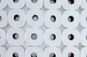 Background pattern of white toilet paper rolls — Stock Photo