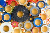 Striking abstract pattern of glue pots and tape — Fotografia Stock
