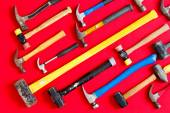 Multiple hammers on a vivid red background — Stock Photo